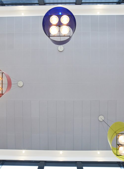 Full view of the Colour All grey ceiling panels in the Bürgerbahnhof